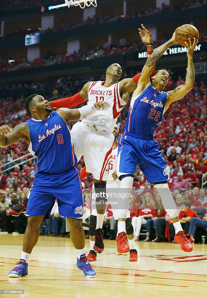 Dwight Howard #12 of the Houston Rockets battles for a rebound with Matt Barnes #22 of the Los Angeles Clippers and Glen Davis #0 of the Los Angeles Clippers during Game Two in the Western Conference Semifinals of the 2015 NBA Playoffs on May 6, 2015 at the Toyota Center in Houston, Texas.