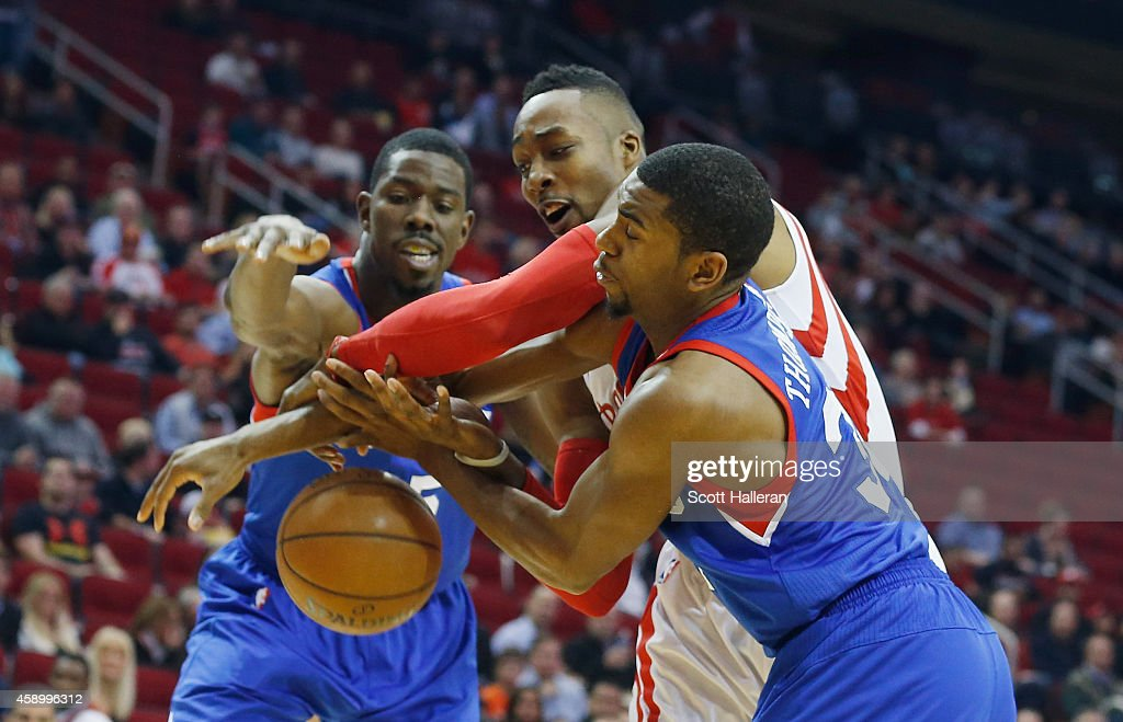 <a gi-track='captionPersonalityLinkClicked' href=/galleries/search?phrase=Dwight+Howard&family=editorial&specificpeople=201570 ng-click='$event.stopPropagation()'>Dwight Howard</a> #12 of the Houston Rockets battles for the basketball against <a gi-track='captionPersonalityLinkClicked' href=/galleries/search?phrase=Henry+Sims&family=editorial&specificpeople=5132323 ng-click='$event.stopPropagation()'>Henry Sims</a> #35 and <a gi-track='captionPersonalityLinkClicked' href=/galleries/search?phrase=Hollis+Thompson&family=editorial&specificpeople=6586021 ng-click='$event.stopPropagation()'>Hollis Thompson</a> #31 of the Philadelphia 76ers during their game at the Toyota Center on November 14, 2014 in Houston, Texas.