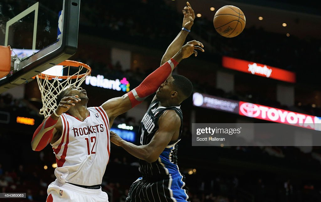 Dwight Howard #12 of the Houston Rockets blocks a shot from Maurice Harkless #21 of the Orlando Magic at Toyota Center on December 8, 2013 in Houston, Texas.