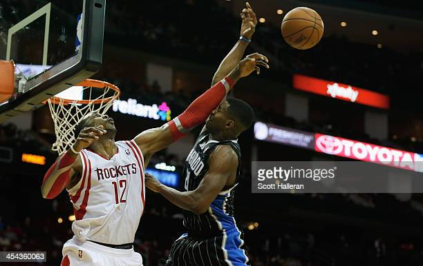 Dwight Howard of the Houston Rockets blocks a shot from Maurice Harkless of the Orlando Magic at Toyota Center on December 8 2013 in Houston Texas...