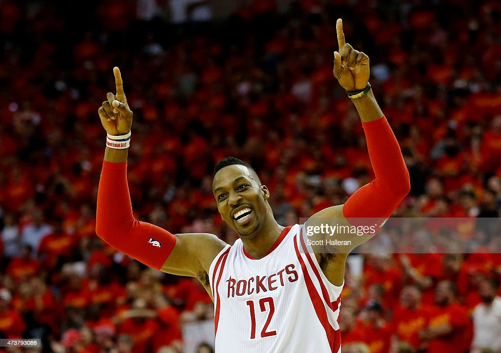 <a gi-track='captionPersonalityLinkClicked' href=/galleries/search?phrase=Dwight+Howard&family=editorial&specificpeople=201570 ng-click='$event.stopPropagation()'>Dwight Howard</a> #12 of the Houston Rockets celebrates after they defeated the Los Angeles Clippers 113 to 100 during Game Seven of the Western Conference Semifinals at the Toyota Center for the 2015 NBA Playoffs on May 17, 2015 in Houston, Texas.