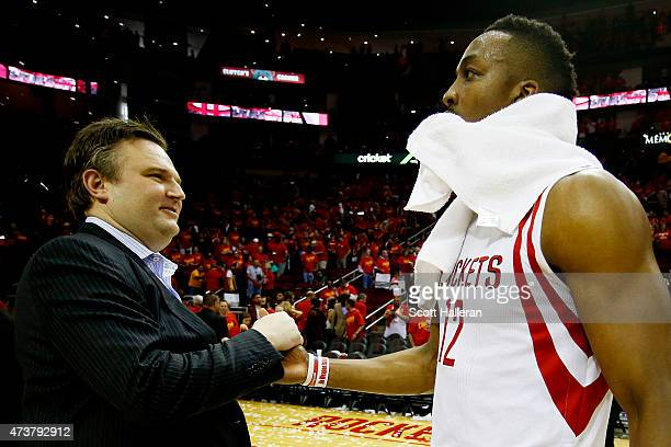 Dwight Howard of the Houston Rockets celebrates with General Manager Daryl Morey after they defeated the Los Angeles Clippers 113 to 100 during Game...