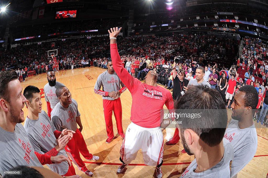 <a gi-track='captionPersonalityLinkClicked' href=/galleries/search?phrase=Dwight+Howard&family=editorial&specificpeople=201570 ng-click='$event.stopPropagation()'>Dwight Howard</a> #12 of the Houston Rockets dances before the game against the Detroit Pistons on March 1, 2014 at the Toyota Center in Houston, Texas.
