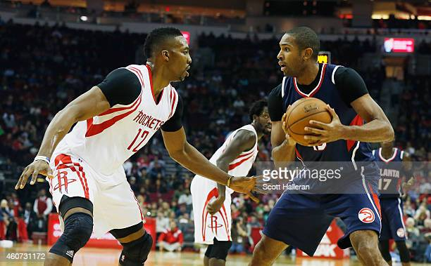 Dwight Howard of the Houston Rockets defends against Al Horford of the Atlanta Hawks during their game at the Toyota Center on December 20 2014 in...