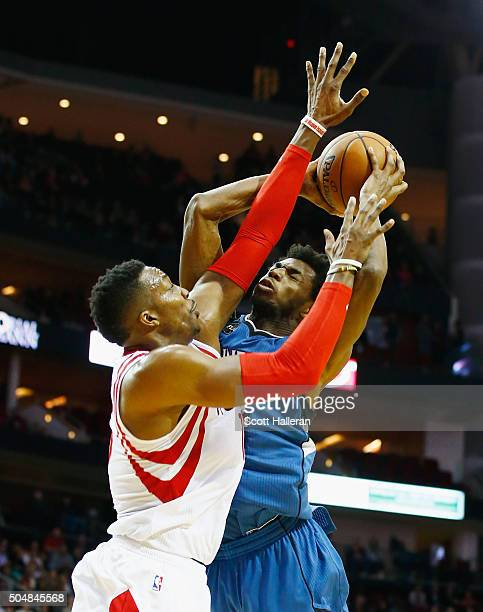 Dwight Howard of the Houston Rockets defends against Andrew Wiggins of the Minnesota Timberwolves during their game at the Toyota Center on January...