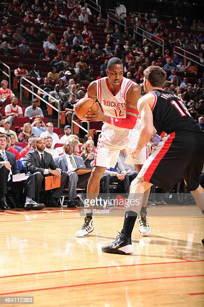 Dwight Howard of the Houston Rockets drives against Joel Freeland of the Portland Trail Blazers on January 20 2014 at the Toyota Center in Houston...