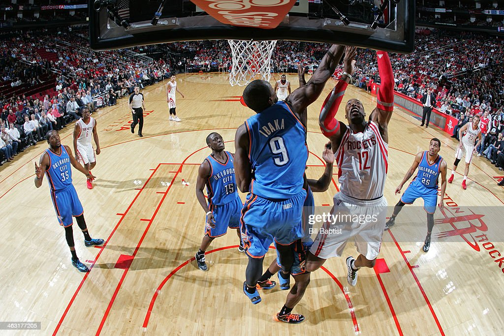 <a gi-track='captionPersonalityLinkClicked' href=/galleries/search?phrase=Dwight+Howard&family=editorial&specificpeople=201570 ng-click='$event.stopPropagation()'>Dwight Howard</a> #12 of the Houston Rockets drives to the basket against the Oklahoma City Thunder on January 16, 2014 at the Toyota Center in Houston, Texas.