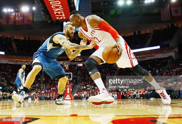 Dwight Howard of the Houston Rockets drives with the basketball against Nikola Pekovic of the Minnesota Timberwolves during their game at the Toyota...