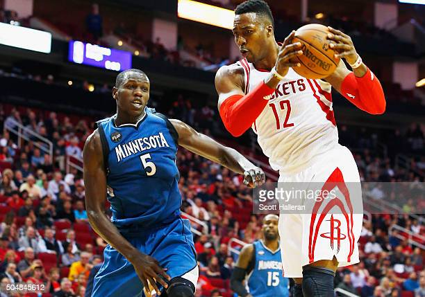 Dwight Howard of the Houston Rockets drives with the basketball against Gorgui Dieng of the Minnesota Timberwolves during their game at the Toyota...