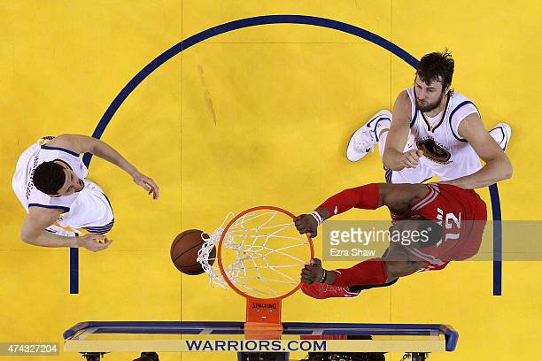 Dwight Howard of the Houston Rockets dunks in the second half against Klay Thompson and Andrew Bogut of the Golden State Warriors during game two of...