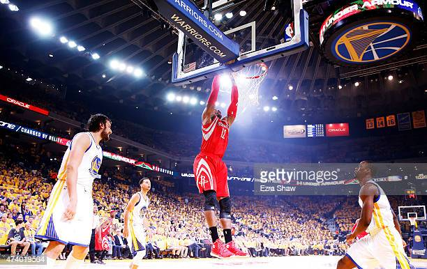 Dwight Howard of the Houston Rockets dunks on Harrison Barnes of the Golden State Warriors in the first quarter during Game One of the Western...