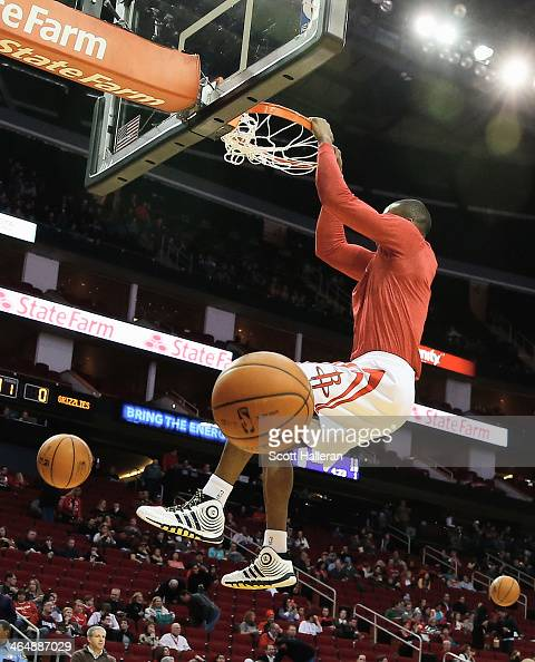 Dwight Howard of the Houston Rockets dunks on the court before the game against the Memphis Grizzlies at the Toyota Center on January 24 2014 in...