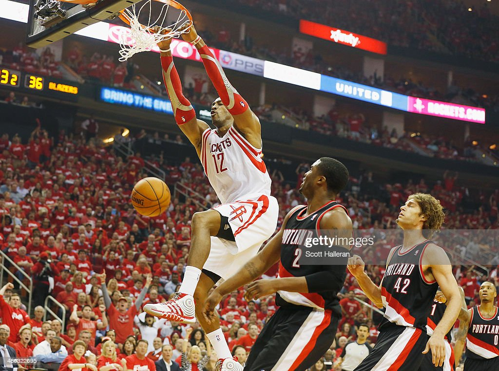 <a gi-track='captionPersonalityLinkClicked' href=/galleries/search?phrase=Dwight+Howard&family=editorial&specificpeople=201570 ng-click='$event.stopPropagation()'>Dwight Howard</a> #12 of the Houston Rockets dunks over <a gi-track='captionPersonalityLinkClicked' href=/galleries/search?phrase=Wesley+Matthews+-+Basketball+Player&family=editorial&specificpeople=804816 ng-click='$event.stopPropagation()'>Wesley Matthews</a> #2 and <a gi-track='captionPersonalityLinkClicked' href=/galleries/search?phrase=Robin+Lopez&family=editorial&specificpeople=2351509 ng-click='$event.stopPropagation()'>Robin Lopez</a> #42 of the Portland Trail Blazers during the first half in Game Two of the Western Conference Quarterfinals during the 2014 NBA Playoffs at Toyota Center on April 23, 2014 in Houston, Texas.