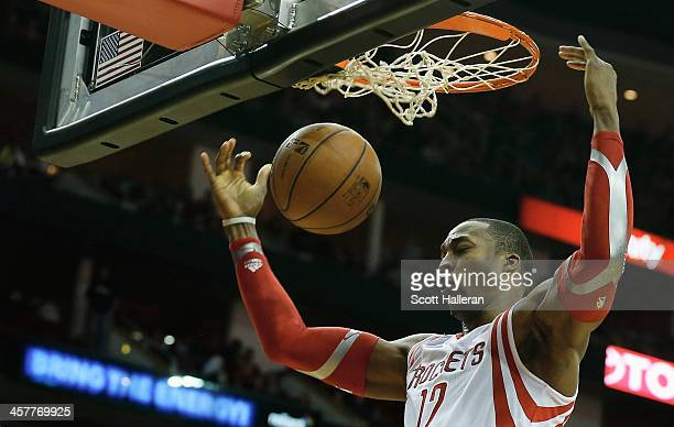 Dwight Howard of the Houston Rockets dunks the ball during the game against the Chicago Bulls at Toyota Center on December 18 2013 in Houston Texas...