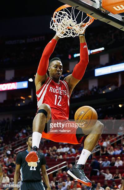 Dwight Howard of the Houston Rockets dunks the basketball during their game against the Minnesota Timberwolves at the Toyota Center on March 27 2015...
