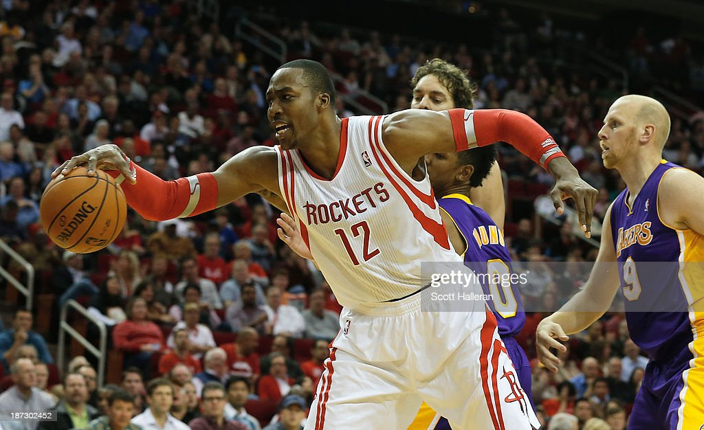 <a gi-track='captionPersonalityLinkClicked' href=/galleries/search?phrase=Dwight+Howard&family=editorial&specificpeople=201570 ng-click='$event.stopPropagation()'>Dwight Howard</a> #12 of the Houston Rockets fighst for the ball with Nick Young #0 and Chris Kamen #9 of the Los Angeles Lakers during the game at Toyota Center on November 7, 2013 in Houston, Texas.