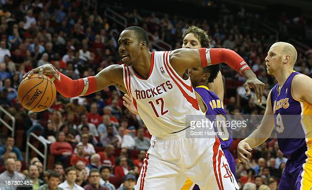 Dwight Howard of the Houston Rockets fighst for the ball with Nick Young and Chris Kamen of the Los Angeles Lakers during the game at Toyota Center...