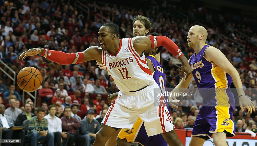 <a gi-track='captionPersonalityLinkClicked' href=/galleries/search?phrase=Dwight+Howard&family=editorial&specificpeople=201570 ng-click='$event.stopPropagation()'>Dwight Howard</a> #12 of the Houston Rockets fighst for the ball with <a gi-track='captionPersonalityLinkClicked' href=/galleries/search?phrase=Pau+Gasol&family=editorial&specificpeople=201587 ng-click='$event.stopPropagation()'>Pau Gasol</a> #16, Nick Young #0 and Chris Kamen #9 of the Los Angeles Lakers during the game at Toyota Center on November 7, 2013 in Houston, Texas.