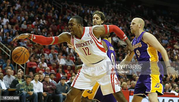 Dwight Howard of the Houston Rockets fighst for the ball with Pau Gasol Nick Young and Chris Kamen of the Los Angeles Lakers during the game at...