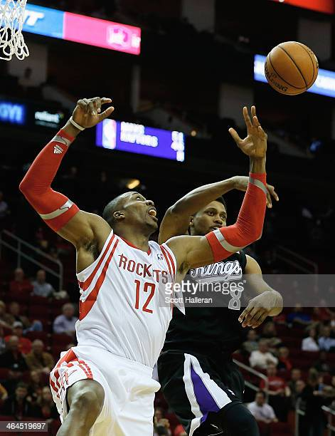 Dwight Howard of the Houston Rockets fights for a rebound with Rudy Gay of the Sacramento Kings during the game at the Toyota Center on January 22...