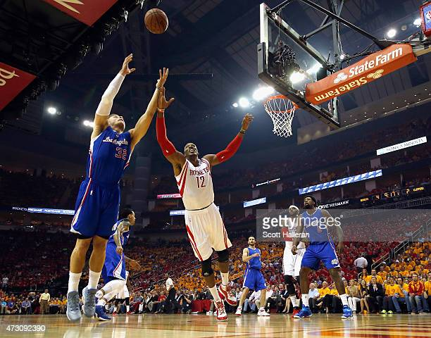 Dwight Howard of the Houston Rockets figts for a rebound with Blake Griffin of the Los Angeles Clippers during Game Five of the Western Conference...