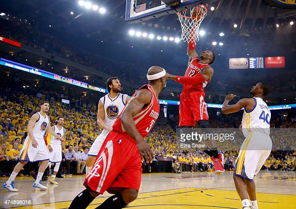 Dwight Howard of the Houston Rockets goes up for a dunk in the first quarter against the Golden State Warriors during game five of the Western...