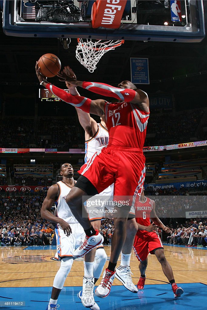 <a gi-track='captionPersonalityLinkClicked' href=/galleries/search?phrase=Dwight+Howard&family=editorial&specificpeople=201570 ng-click='$event.stopPropagation()'>Dwight Howard</a> #12 of the Houston Rockets goes up for a shot against the Oklahoma City Thunder during an NBA game on March 11, 2014 at the Chesapeake Energy Arena in Oklahoma City, Oklahoma.