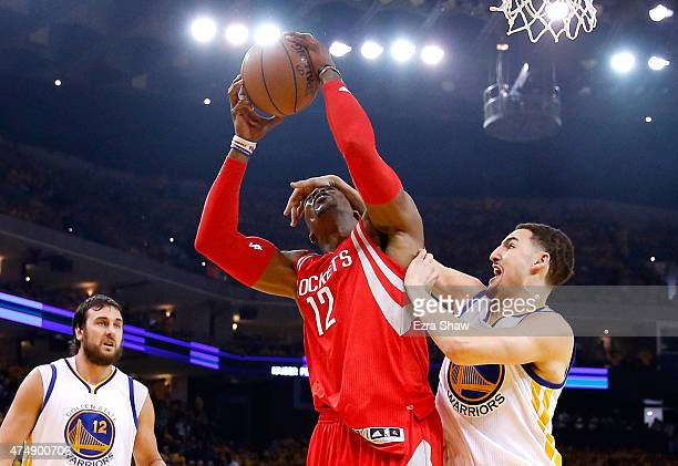 Dwight Howard of the Houston Rockets goes up for a shot as he is hit by Klay Thompson of the Golden State Warriors in the first half during game five...