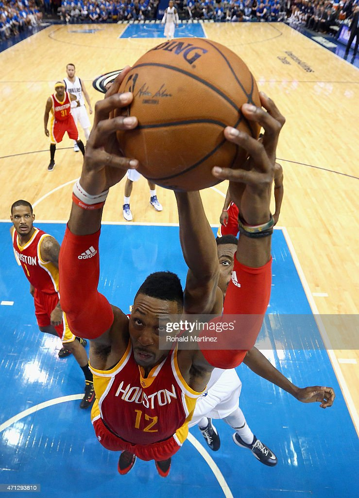 Dwight Howard #12 of the Houston Rockets grabs a rebound against Al-Farouq Aminu #7 of the Dallas Mavericks during Game Four of the Western Conference quarterfinals of the 2015 NBA Playoffs at American Airlines Center on April 26, 2015 in Dallas, Texas.