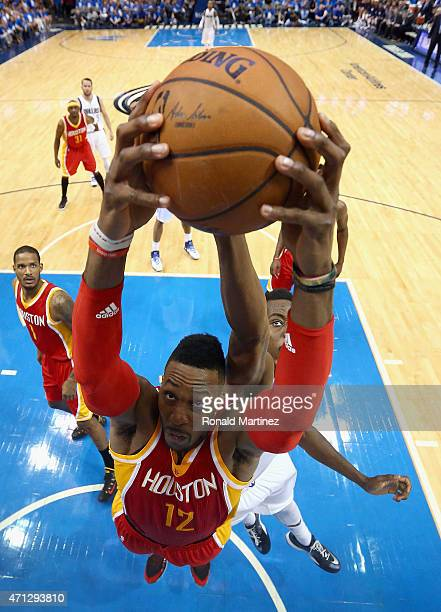Dwight Howard of the Houston Rockets grabs a rebound against AlFarouq Aminu of the Dallas Mavericks during Game Four of the Western Conference...
