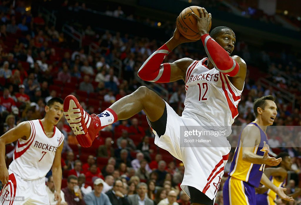 <a gi-track='captionPersonalityLinkClicked' href=/galleries/search?phrase=Dwight+Howard&family=editorial&specificpeople=201570 ng-click='$event.stopPropagation()'>Dwight Howard</a> #12 of the Houston Rockets grabs a rebound during the game against the Los Angeles Lakers at Toyota Center on November 7, 2013 in Houston, Texas.