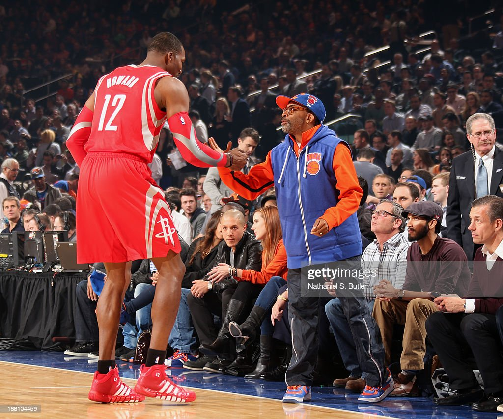 <a gi-track='captionPersonalityLinkClicked' href=/galleries/search?phrase=Dwight+Howard&family=editorial&specificpeople=201570 ng-click='$event.stopPropagation()'>Dwight Howard</a> #12 of the Houston Rockets greets film director <a gi-track='captionPersonalityLinkClicked' href=/galleries/search?phrase=Spike+Lee&family=editorial&specificpeople=156419 ng-click='$event.stopPropagation()'>Spike Lee</a> before a game against the New York Knicks at Madison Square Garden in New York City on November 14, 2013.