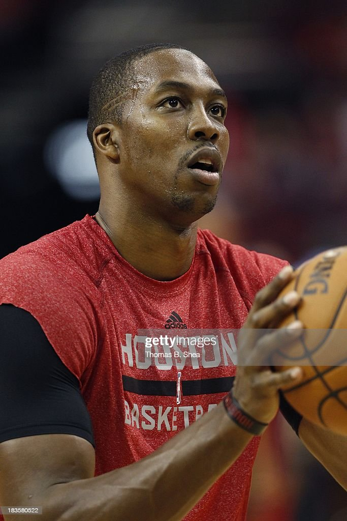 Dwight Howard #12 of the Houston Rockets in warm up before playing against the New Orleans Pelicans in a preseason NBA game on October 5, 2013 at Toyota Center in Houston, Texas. The Pelicans won 116 to 115.