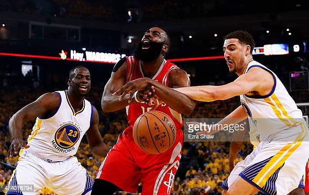 Dwight Howard of the Houston Rockets is fouled by Klay Thompson of the Golden State Warriors in the first quarter during Game One of the Western...