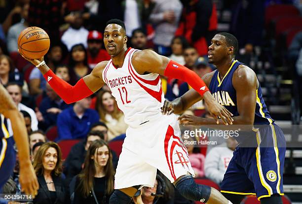 Dwight Howard of the Houston Rockets looks to pass against Ian Mahinmi of the Indiana Pacers during their game at the Toyota Center on January 10...