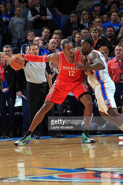 Dwight Howard of the Houston Rockets moves around Kendrick Perkins of the Oklahoma City Thunder during an NBA game on December 29 2013 at the...