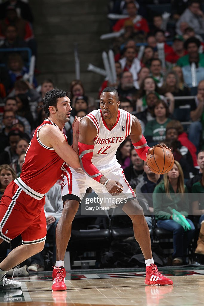 Dwight Howard #12 of the Houston Rockets posts up against Zaza Pachulia #27 of the Milwaukee Bucks on February 8, 2014 at the BMO Harris Bradley Center in Milwaukee, Wisconsin.
