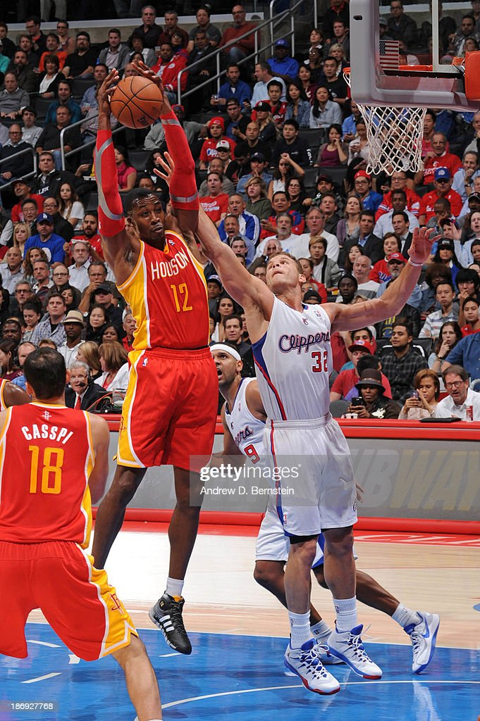 Dwight Howard #12 of the Houston Rockets reaches for a rebound against Blake Griffin #32 of the Los Angeles Clippers at Staples Center on November 4, 2013 in Los Angeles, California.