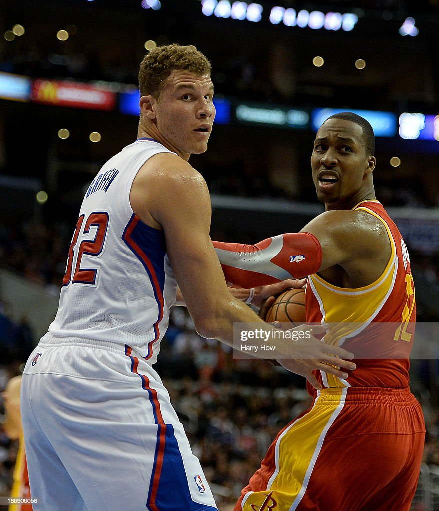 Dwight Howard #12 of the Houston Rockets reacts as he his called for a travel in front of Blake Griffin #32 of the Los Angeles Clippers during the first quarter at Staples Center on November 4, 2013 in Los Angeles, California.