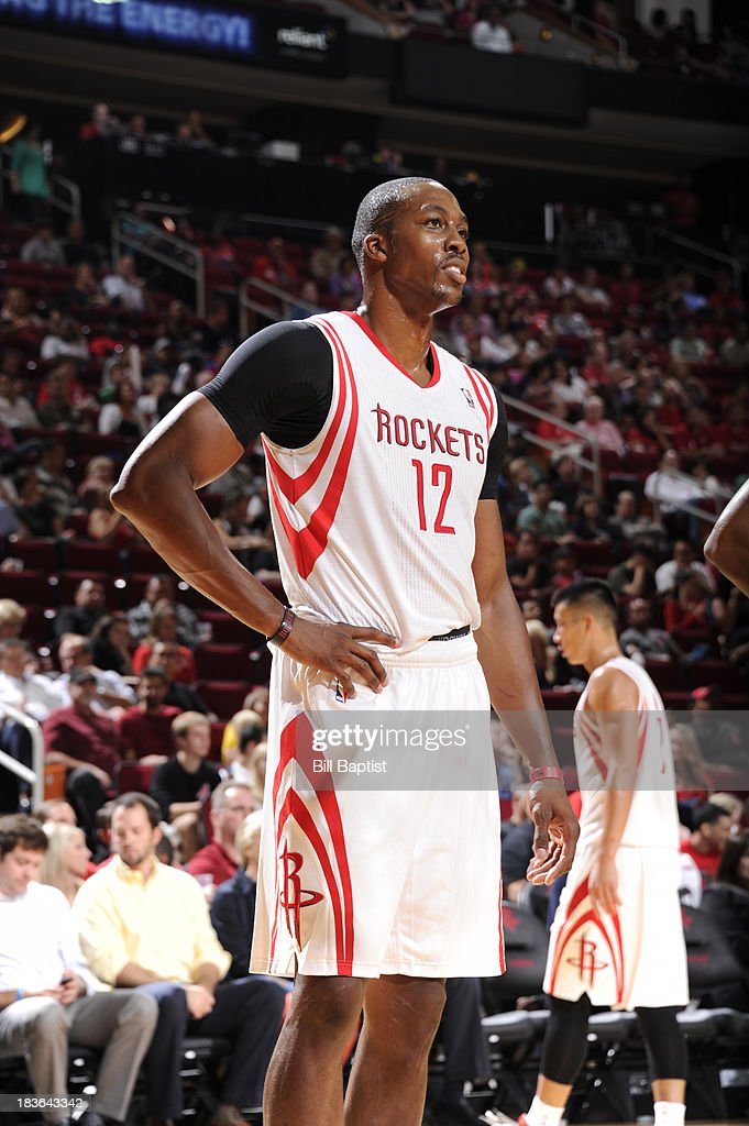 <a gi-track='captionPersonalityLinkClicked' href=/galleries/search?phrase=Dwight+Howard&family=editorial&specificpeople=201570 ng-click='$event.stopPropagation()'>Dwight Howard</a> #12 of the Houston Rockets reacts to a play during the 2013 NBA pre-season game against the New Orleans Pelicans on October 5, 2013 at the Toyota Center in Houston, Texas.