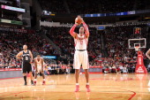 Dwight Howard of the Houston Rockets shoots a free throw against the San Antonio Spurs on January 28 2014 at the Toyota Center in Houston Texas NOTE...