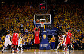 Dwight Howard of the Houston Rockets shoots a free throw in the third quarter against the Golden State Warriors during game two of the Western...