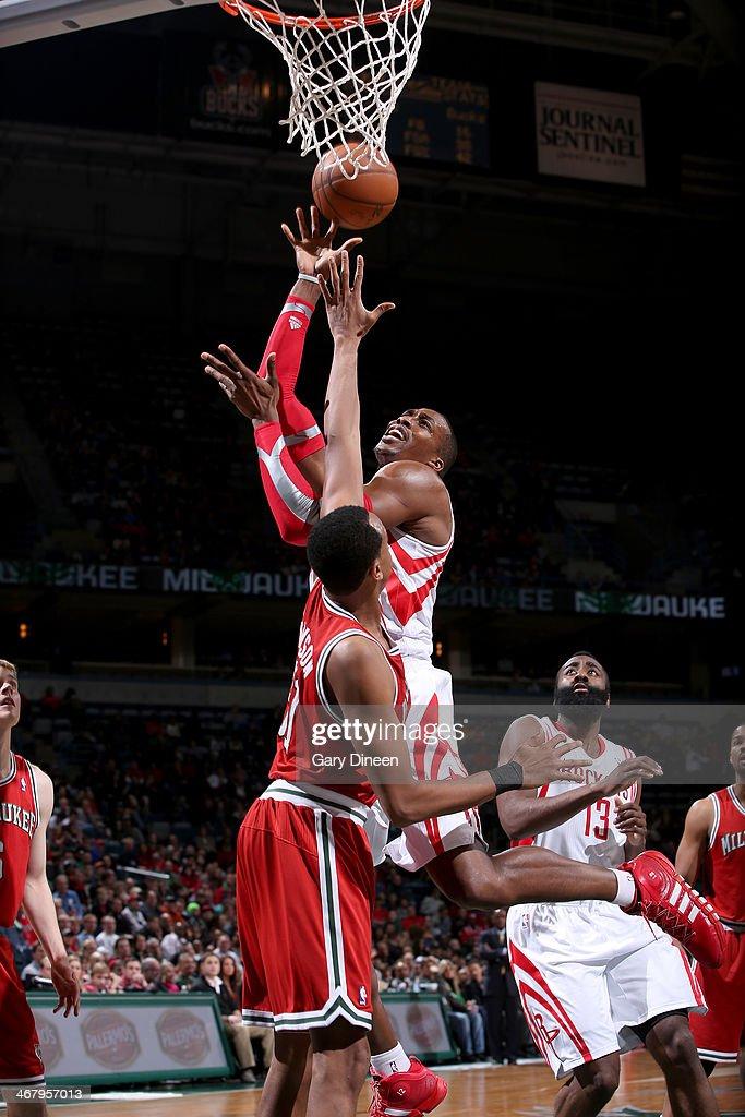 Dwight Howard #12 of the Houston Rockets shoots against John Henson #31 of the Milwaukee Bucks on February 8, 2014 at the BMO Harris Bradley Center in Milwaukee, Wisconsin.