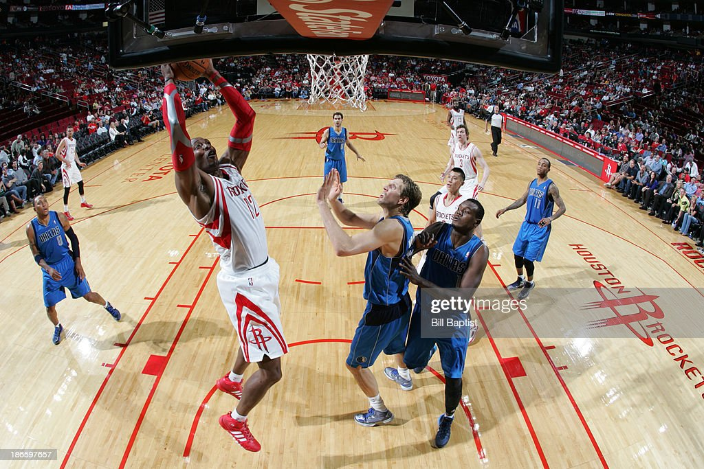 <a gi-track='captionPersonalityLinkClicked' href=/galleries/search?phrase=Dwight+Howard&family=editorial&specificpeople=201570 ng-click='$event.stopPropagation()'>Dwight Howard</a> #12 of the Houston Rockets shoots the ball against <a gi-track='captionPersonalityLinkClicked' href=/galleries/search?phrase=Dirk+Nowitzki&family=editorial&specificpeople=201490 ng-click='$event.stopPropagation()'>Dirk Nowitzki</a> #41 of the Dallas Mavericks on November 1, 2013 at the Toyota Center in Houston, Texas.