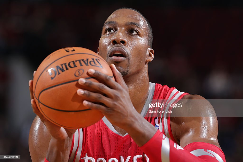 <a gi-track='captionPersonalityLinkClicked' href=/galleries/search?phrase=Dwight+Howard&family=editorial&specificpeople=201570 ng-click='$event.stopPropagation()'>Dwight Howard</a> #12 of the Houston Rockets shoots the ball against the Portland Trail Blazers on November 5, 2013 at the Moda Center Arena in Portland, Oregon.