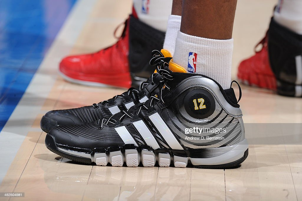 <a gi-track='captionPersonalityLinkClicked' href=/galleries/search?phrase=Dwight+Howard&family=editorial&specificpeople=201570 ng-click='$event.stopPropagation()'>Dwight Howard</a> #12 of the Houston Rockets showcases his sneakers against the Los Angeles Clippers at Staples Center on November 4, 2013 in Los Angeles, California.