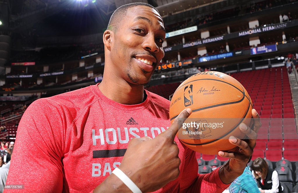 <a gi-track='captionPersonalityLinkClicked' href=/galleries/search?phrase=Dwight+Howard&family=editorial&specificpeople=201570 ng-click='$event.stopPropagation()'>Dwight Howard</a> #12 of the Houston Rockets shows the new basketball engraved with the new NBA Commissioner Adam Silver's name on February 1, 2014 at the Toyota Center in Houston, Texas.