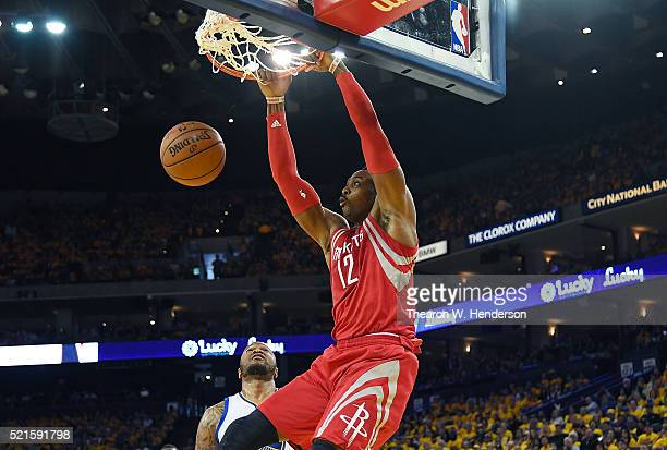 Dwight Howard of the Houston Rockets slam dunks over Marreese Speights of the Golden State Warriors in the second quarter in Game One of the Western...