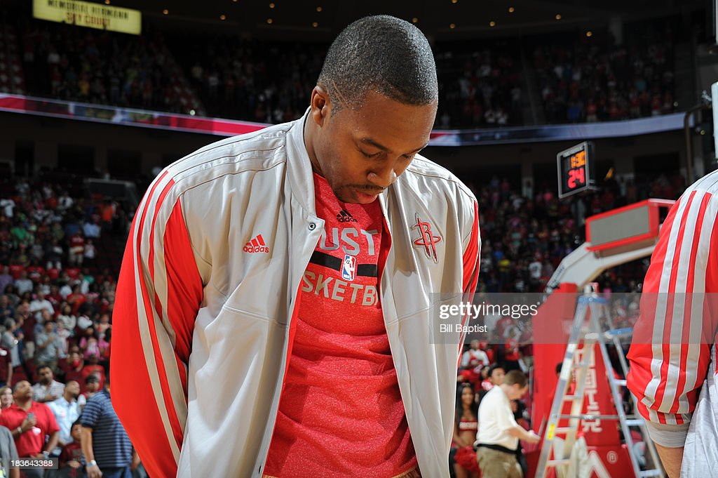 <a gi-track='captionPersonalityLinkClicked' href=/galleries/search?phrase=Dwight+Howard&family=editorial&specificpeople=201570 ng-click='$event.stopPropagation()'>Dwight Howard</a> #12 of the Houston Rockets stands for the National Anthem before the game against the New Orleans Pelicans before the 2013 NBA pre-season game on October 5, 2013 at the Toyota Center in Houston, Texas.