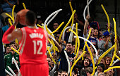 Dwight Howard of the Houston Rockets takes a free throw as Denver Nuggets fans attempt to distract him at Pepsi Center on December 17 2014 in Denver...